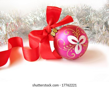 New Year`s or christmas toy decorated by bow of red ribbon isolated
