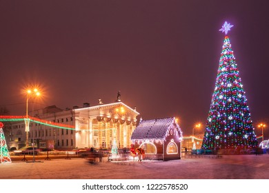 New Year's City Square Gomel with a Christmas tree illumination and other decorations against the backdrop of dramatic theater