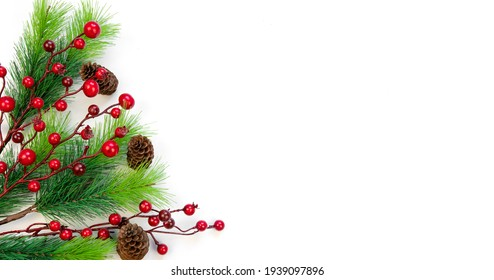 New Year's composition. Christmas background top view on white background. Fir branches, red berries, cones. Place for your text