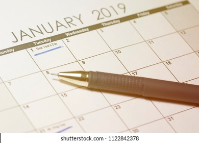 New Year's Day 2019 on calendar. Pen and calendar january 2019, with drawn text New Year's Day. Toned Image.