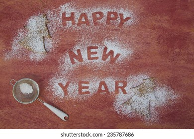 """New Year's Day background with sugar trace inscription: """"Happy New Year"""""""