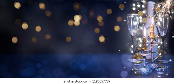 New years eve celebration background with champagne, Christmas and New Year holidays background, winter season.