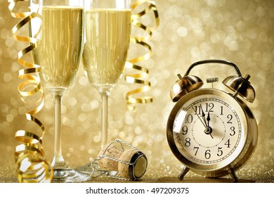 New years eve celebration background with champagne and alarm clock