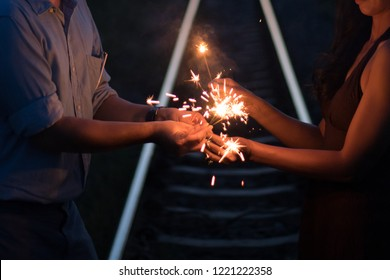 new years eve celebration with hand held sparkler fireworks