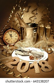 New Years Eve celebration. Holidays served table with champagne and decorations