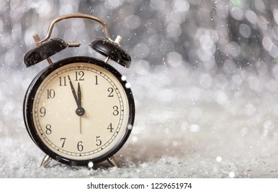 New Years eve countdown. Minutes to midnight on a vintage alarm clock, copy space
