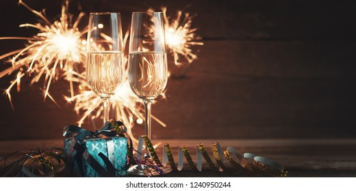 new years eve decoration with champaign glasses and burning sparkler