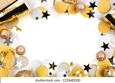 New Years Eve frame of confetti and decor isolated on a white background