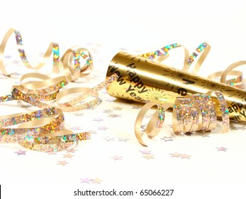 New Year's Eve noisemaker and party confetti on a white background