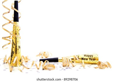 New Years Eve party noisemaker border with confetti and streamers over a white background