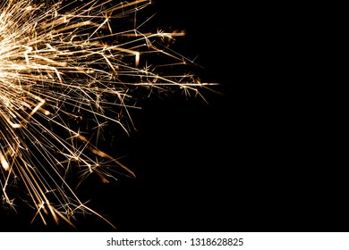 New years eve sparkler isolated on black. Shiny blow of firework sparks.