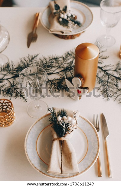 New Year's festive table setting, cutlery, decorations, New Year's decor, Christmas serving