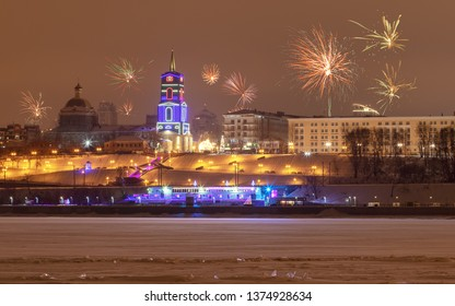 New Year's firework. City of Perm view from the other side of the Kama River.