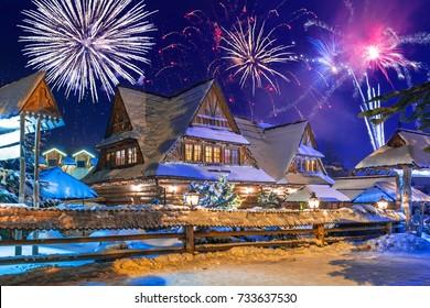 New Years firework display in Zakopane at snowy night, Poland