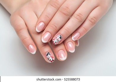 New Year's  French white manicure with painted snowman on oval nails