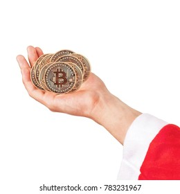 New Year's gift. Golden Bitcoins. Bitcoin in the hands. Photo (new virtual money ) New crypto currency in the form of the coins.