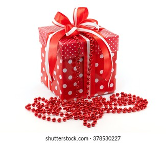 New Year's gift in a red box and garland. White background