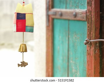 'New year's greeting background. Korean traditional wind chime & vintage door.
