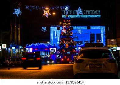New Year's illumination of the city. Christmas garlands on city lighting pylons. Glowing urban New Year's designs. Christmas tree. Sennaya Ploshchad, St. Petersburg, Russia, December 31, 2017