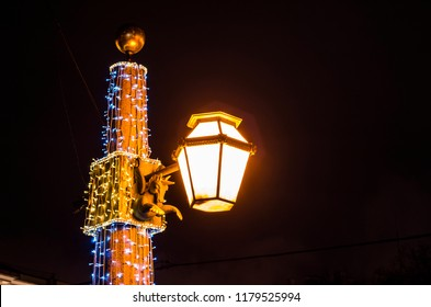 New Year's illumination of the city. Lomonosov Square for the New Year. Lomonosov Bridge decorated for Christmas. A historic lantern on the bridge adorned to the new year.