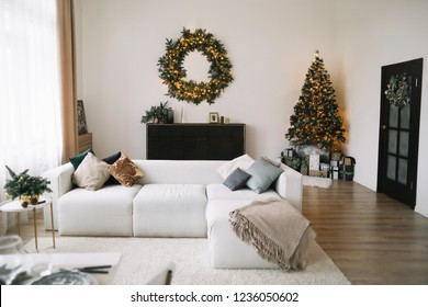 New Year's interior. Decorated Christmas tree with gifts. Wreath of spruce  with garland. Christmas decorations. Holiday concept