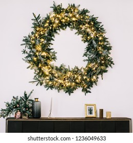 New Year's interior.  Wreath of spruce  with garland. Christmas decorations. Holiday concept