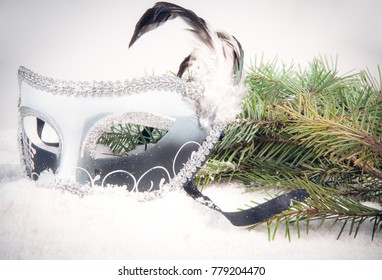 New Year's mask with a spruce branch in the snow