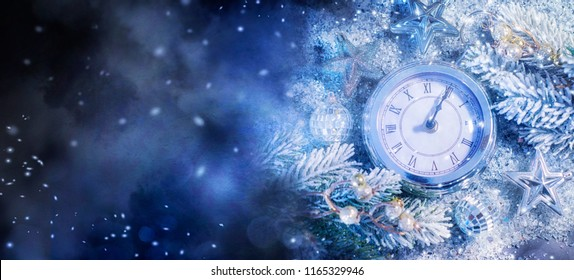 New Year's at midnight - Old clock with stars snowflakes and holiday lights. Christmas and New Year background