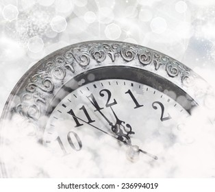 New Year's at midnight - old clock in snow