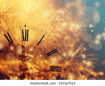 New Year's at midnight - Old clock with fireworks and holiday lights - Shutterstock ID 515167513