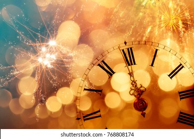 New Year's at midnight - Old clock with stars snowflakes and holiday lights - Shutterstock ID 768808174