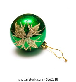 New Year's ornament for a fur-tree in the form of a green glass sphere. Isolation on white. Shallow DOF.