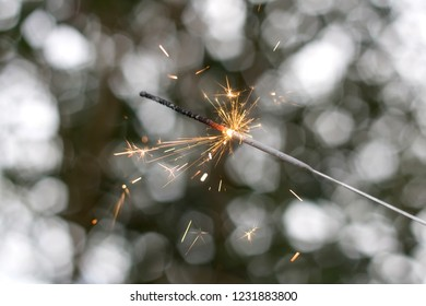 New Year's party sparkler with beautiful bokeh background.