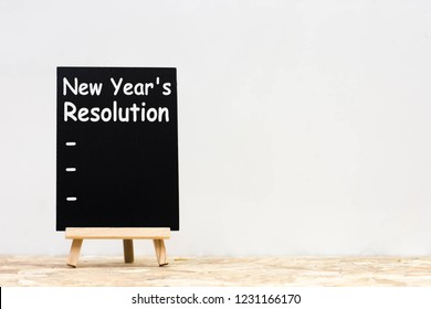 New Year's Resolution 2019 on chalkboard for copy space .  Word 2019 goals blackboard on table white background. Target success concept.