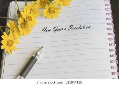new year's resolution message with flower and pen