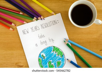 New year's resolution on the wooden background with a cup of coffee