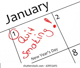new years resolution writing with a red pen in a calendar