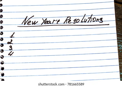 New Year's Resolution written on a notepad close-up . New Year resolutions concept.
