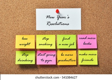 New Year's Resolutions on notice papers hanging on a cork bulletin board