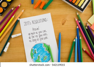 New year's resolutions on the wooden background with multicolored paints