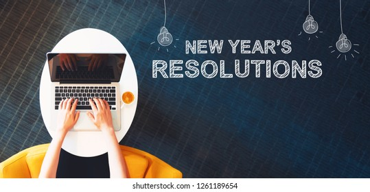 New Year's Resolutions with person using a laptop on a white table