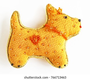 New Year's toy made of fabric and beads (Yellow Dog - symbol of 2018)