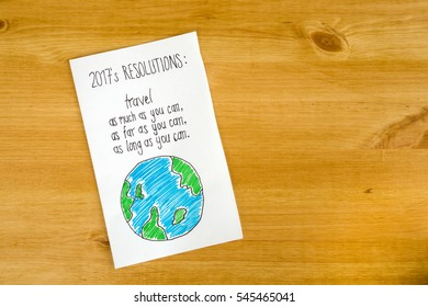 New year's travel resolution on the wooden background