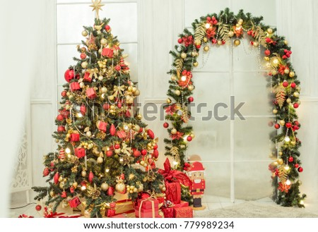 new years tree and the arch are decorated in classic red gold color background decorations