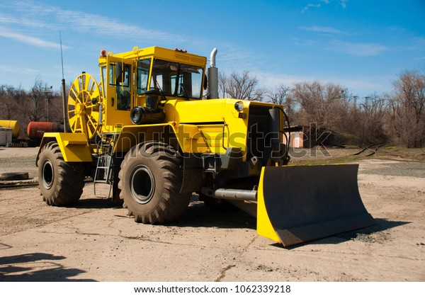 A new yellow cable laying machine for working in a quarry.