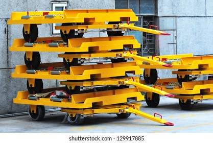 New yellow flatbed trailers stocked at warehouse