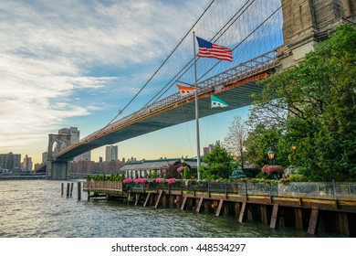 New York, New York - 1 July 2016: The River Cafe nestled under the Brooklyn Bridge in New York City.