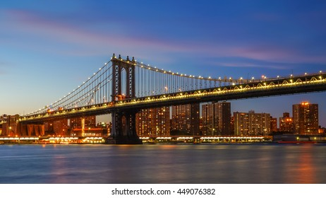 New York, New York - 1 July 2016: Manhattan Bridge in New York City over East River during sunset.