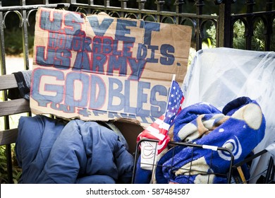 NEW YORK - 11 NOV 2016: The belongings of a homeless US Army veteran on a park bench outside the opening ceremony in Madison Square Park before the annual Americas Parade on Veterans Day in Manhattan.