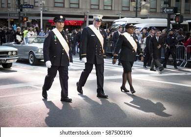 NEW YORK - 11 NOV 2016: 2016 Grand Marshals Stephanie Dawson, Joseph Duggan Jr., and Nelson Vergara march in the annual Americas Parade up 5th Avenue on Veterans Day in Manhattan.